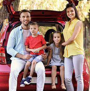 family behind car - auto insurance